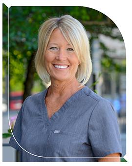 Dr. Jill DuLac smiling in her scrubs