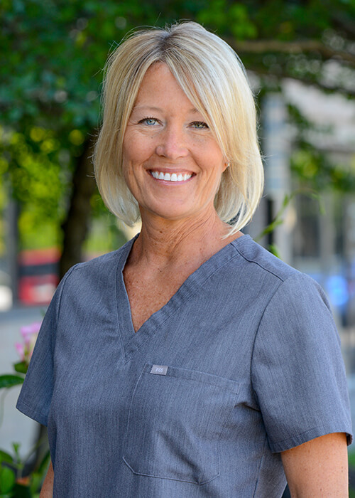 Dr. Jill DuLac outside in her scrubs